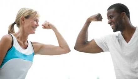 Man and woman flexing arms