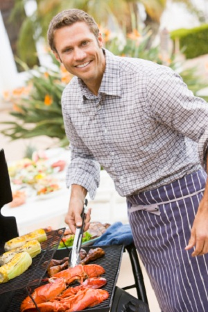 man grilling food for barbecue
