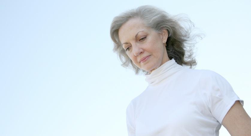 older woman looking downward