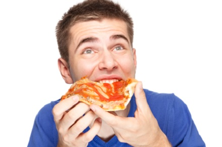 man eating pizza