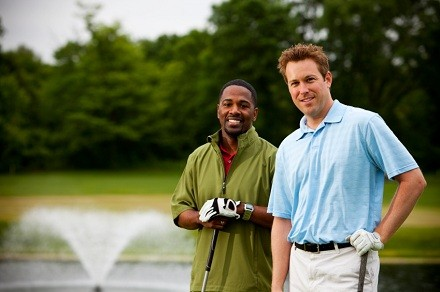 2 golfers on a golf course