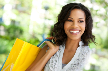 Portrait of beautiful woman with shopping bags