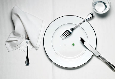 single pea on a dinner plate