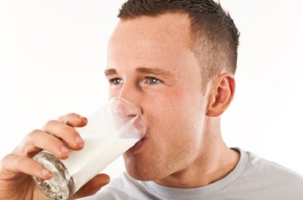 man drinking milk out of glass