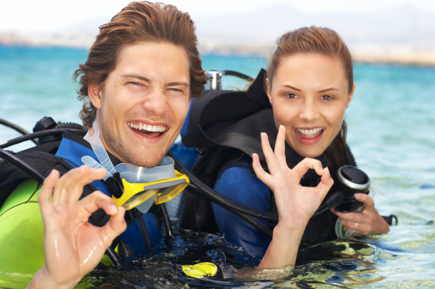 A young couple out scuba diving